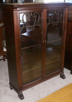two door walnut antique bookcase with lattice work doors