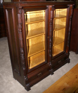 eastlake Victorian solid walnut antique beveled glass door bookcase