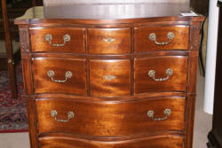 Serpentine front mahogany antique chest