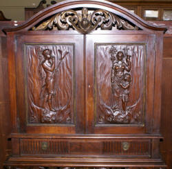 walnut heavily carved antique blind door crystal cabinet with built in butlers desk