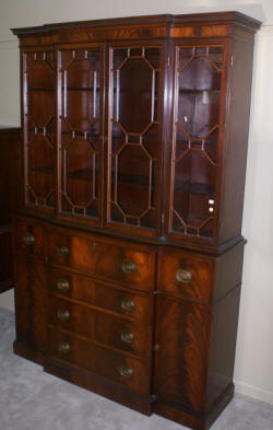 two piece mahogany breakfront china cabinet with butlers desk