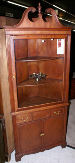 One door mahogany corner cabinet