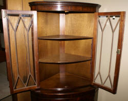English flame mahogany antique corner cabinet
