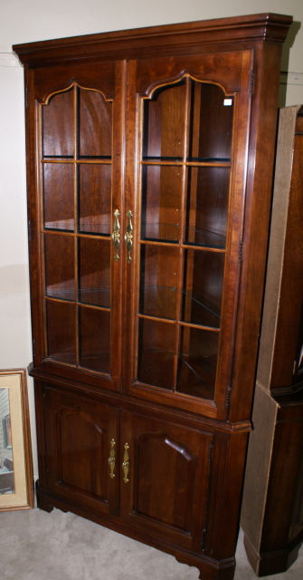20 Corner Cabinets To Make A Clutter Free Bathroom Space: Solid Cherry Two Door Modern Corner Cabinet