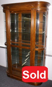 Curved end lighted cherry finish curio cabinet by Pulaski Furniture Company