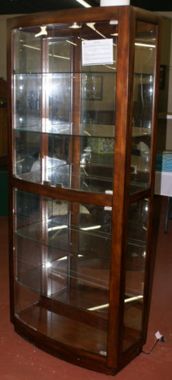 Bow front lighted glass/ mirrored curio cabinet
