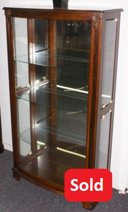 Mahogany bow front glass door curio cabinet by Pulaski Furniture Company