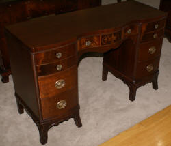 inlaid mahogany kneehole desk