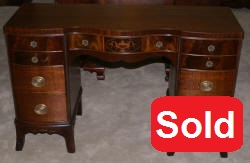 Urn inlaid mahogany kneehole desk