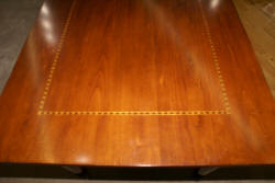 Banded inlaid mahogany bow front desk