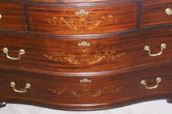Heavily inlaid antique mahogany bow front dresser