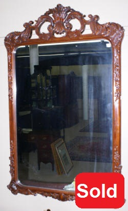 heavily carved french antique mirror