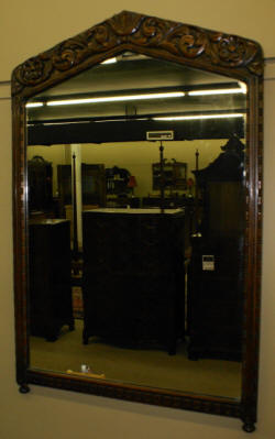 heavily carved walnut antique mirror