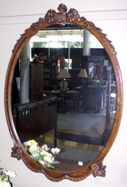 oval walnut french carved mirror