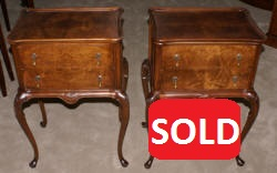 Matched pair of mahogany round drum top Regency night stands
