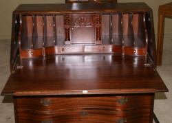 Antique mahogany serpentine front mahogany governor Winthrop desk