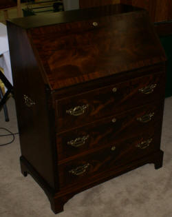 Serpentine front red mahogany Chippendale secretary desk