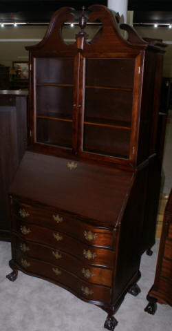 Serpentine front mahogany antique secretary desk