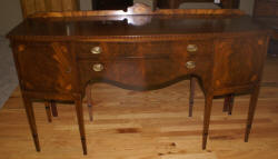 Inlaid bow front walnut sideboard