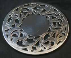 Round sterling silver and glass trivet