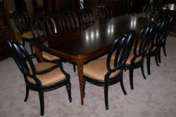 Modern Bassett Cherry dining room table and set of 12 painted black regency dining room chairs