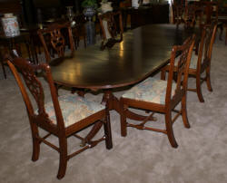 Oval banded inlaid mahogany dining room table and six solid mahogany dining room chairs