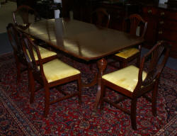 Mahogany banded inlaid Duncan Phyfe dining room table and set of six shield back dining room chairs