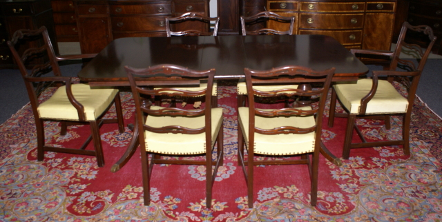 Mahogany Duncan Phyfe dining room table and set of six ribbon back ...