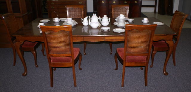 Queen Anne solid cherry dining room table and cane back chairs