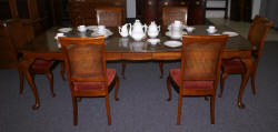 solid cherry dining room table and six cane back dining room chairs