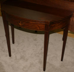 Mahogany urn inlaid flip top game table