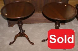 Matched pair of round paw foot side tables